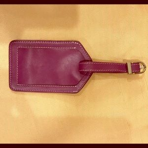 Purple leather luggage tag